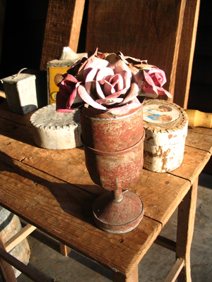 1994-Close-up-still-life-objects-recycled-tin,-paint,-wood-table